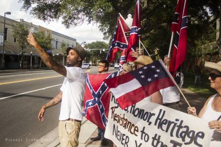Confederate flag supporters and an opponent (Gainesville, Florida, 2015)